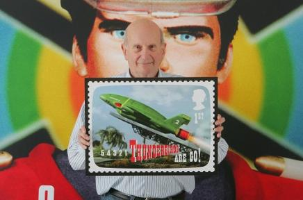 Gerry Anderson with Thundebird 2 stamp, under the watchful eyes of the indestructibel Captain Scarlet.