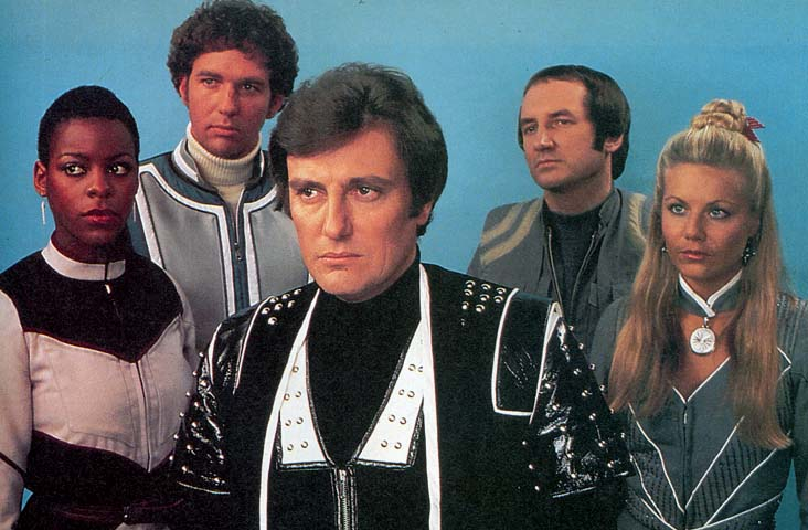 Season 4 Cast, with Paul Darrow as Avon in the foreground.