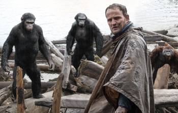 Human Jason Clarke finds relations strained with simian neighbors (l to r) Andy Serkis, Toby Kebbell, and Karin Konoval in DAWN OF THE PLANET OF THE APES.
