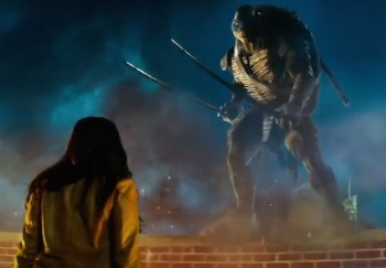 Megan Fox (back to camera) confronts one of the TEENAGE MUTANT NINJA TURTLES. That's Leonardo, if you care. We don't.
