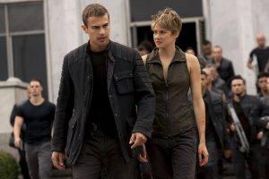 "Theo James as Tobias or ""Four"" and Shailene Woodley as Tris."